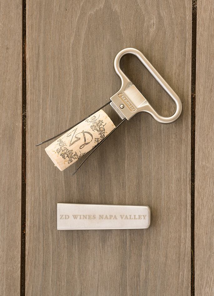 A ZD Wines engraved ah-so wine opener and cork.