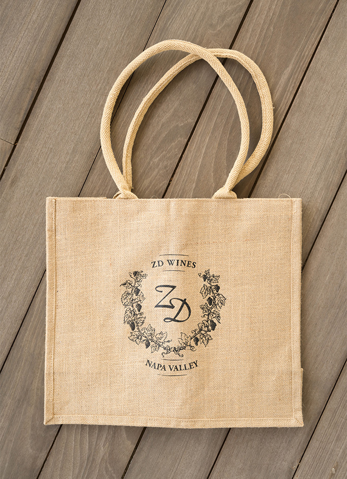A jute material tote bag with the ZD Wines logo